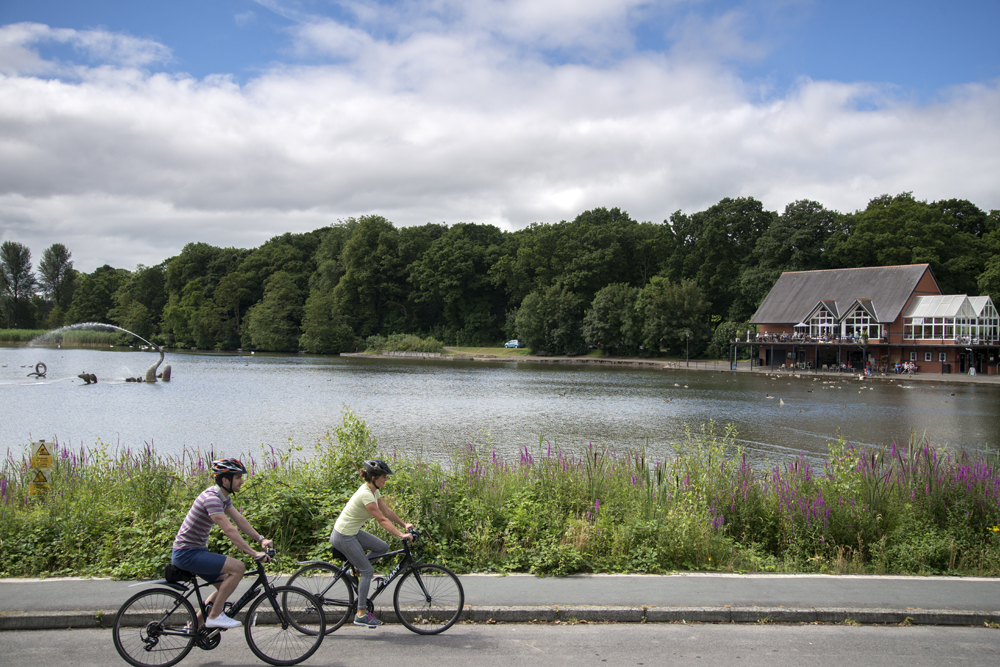 Two people cycling in a lakeside